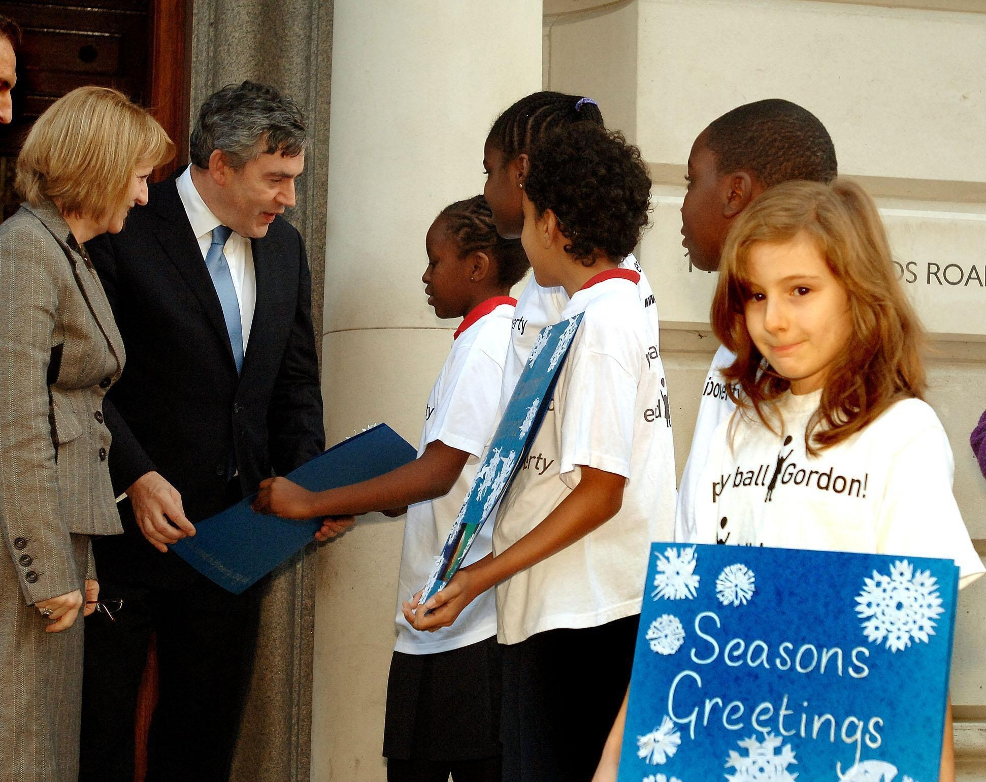 Bev and Gordon Brown talking to young people about the End Child Poverty Campaign